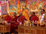 Lamas with a Dorje Shugden thangka behind them (to the left)