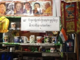Right under photos of holy beings is a discriminatory sign banning Shugden practitioners. Where is the compassion and equality?
