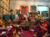 Geshe Konchok Gyeltsen leading a puja. Despite the difficulties, Geshe-la keeps his commitments