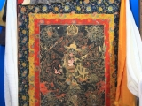 This thangka, borrowed from His Holiness Trijang Rinpoche, was carried by His Holiness the Dalai Lama during the escape from Tibet in 1959.