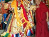 Dorje Shugden rejoices with a special vajra dance during the opening of Shar Gaden Monastery. He holds Kensur Rinpoche Lobsang Phende as he dances, to show his pleasure at Kensur Rinpoche's deeds