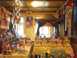 His Eminence Gonsar Rinpoche was recently in Rabten Chodarling (the Czech Republic) granting Vajrapani initiation. Elaborate offerings were made on the altar, next to which hangs a portrait of their founder (who is Gonsar Rinpoche's teacher), Geshe Rabten