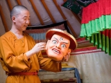 His Eminence Zava Damdin Rinpoche of Mongolia, and a dedicated Dorje Shugden practitioner, gazing at a detailed and lifelike Dorje Shugden mask