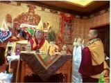 A young Denma Gonsa Rinpoche makes mandala offerings to Ven. Nyitrul Rinpoche
