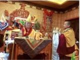A young Denma Gonsa Rinpoche making a mandala offering to his teacher Nyitrul Rinpoche