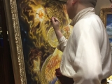 A talented artist, pictured here is His Eminence Zava Damdin Rinpoche completing a painting