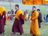 H.H. Kyabje Trijang Chocktrul Rinpoche arriving at a puja commemorating his 35th birthday, escorted by H.E. Gonsar Rinpoche and Ven Rabten Rinpoche