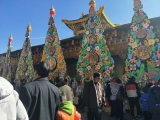 Visitors admiring and inspecting the towering colourful tormas or sculptures on display at Sampheling Monastery during the annual festival.