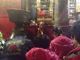 Lama Thubten Phurpu meditates with students inside Kumbum Monastery
