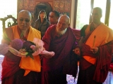 Kyabje Gangchen Rinpoche assisted by Lama Thupten Phurbu