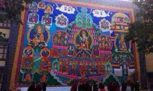 Huge Guru Rinpoche thangka hung in Sera Je