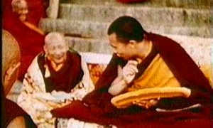 Kyabje Ling Rinpoche sitting on the right side of a young Dalai Lama in an old footage of Tibet