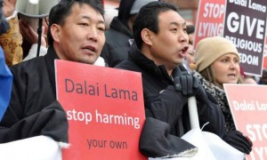 Tibetans protesting because the Dalai Lama banned their religion 18 years ago