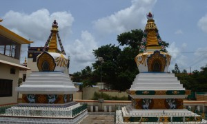 The richly decorated stupas of Kyabje Trijang Rinpoche and Kyabje Zong Rinpoche stands precariously within the compound of the monastery that rejects Dorje Shugden, the protector deity proliferated by these two great lamas