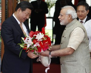 India's PM Modi presents a bouquet to China's President Xi before their meeting in Ahmedabad