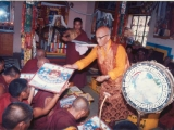Choyang Kuten handing out thangka in the Madhayamaka Centre, UK