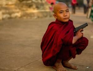 wpid-buddhist-monk-with-gun